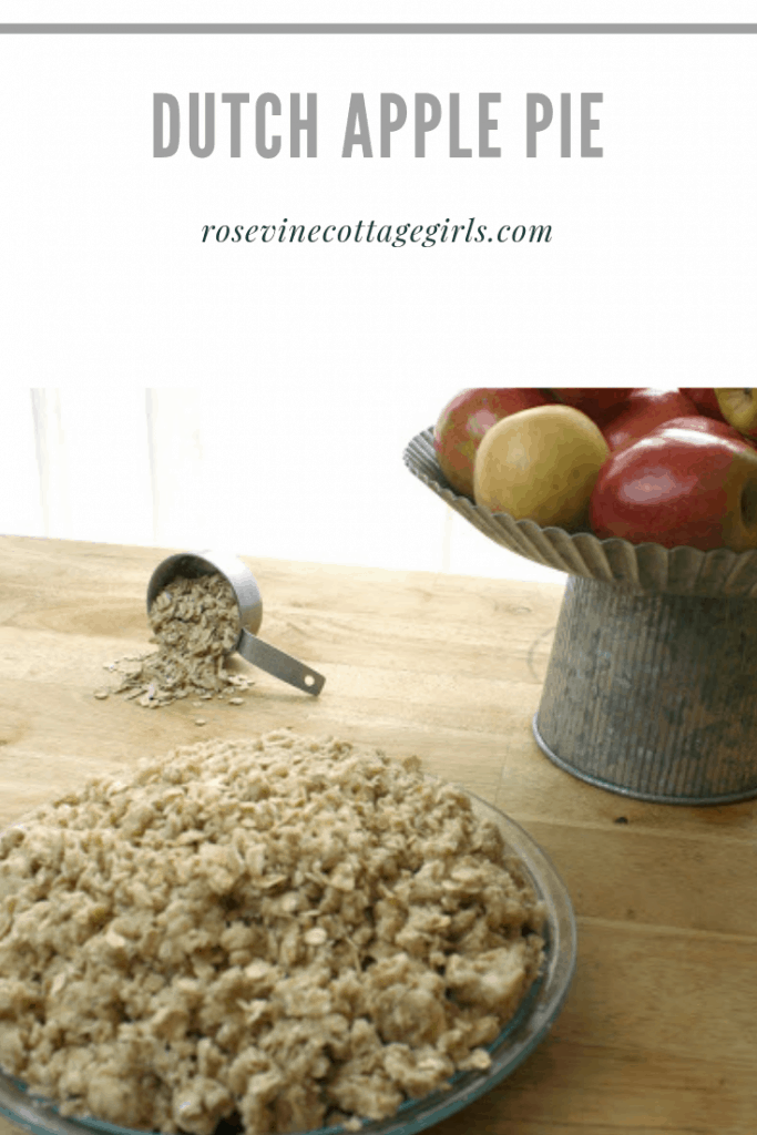 Picture of a dutch apple pie, a scoop of oats pouring out of measuring spoon and a metal cake plate with red apples |Dutch Apple Pie Recipe, Apple Pie, Oatmeal Apple Pie, Apple Pie Recipe, Dutch Apple Pie Recipe, Organic Apple Pie, by RosevineCottageGirls.com