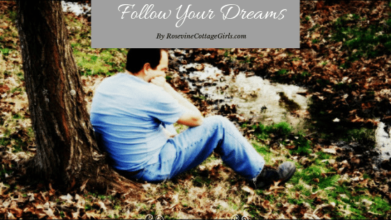 Follow your dreams | photo of a man leaning against a tree daydreaming near a creek | rosevinecottagegirls.com