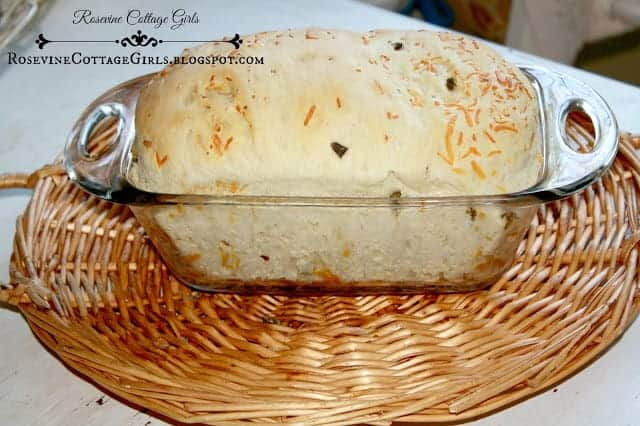 image of a loaf of jalapeno cheese bread in a bread pan by the rosevinecottagegirls.com