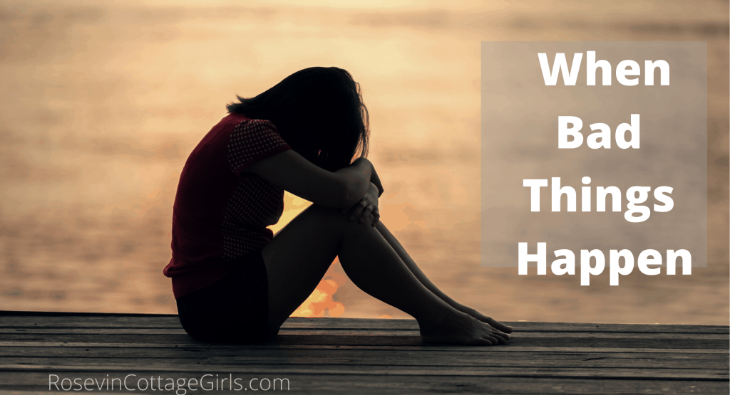 When bad things happen | rosevinecottagegirls.com | girl at the end of a pier with her head on her knees at sunset