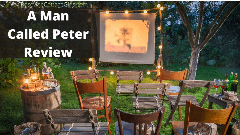 An outdoor family movie event with chairs set up in a yard and a projector screen | A Man Called Peter | RosevineCottageGirls.com
