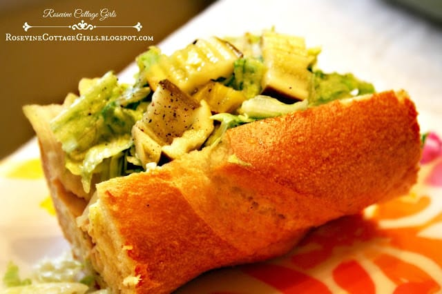photo of a turkey sub sandwich on a floral plate with lettuce, pickles, turkey, cheese by rosevinecottagegirls.com