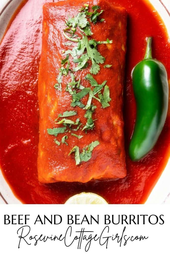 Beef and Bean Burrito pinnable image  Image of a beef and bean burrito covered in red sauce and topped with chopped cilantro and a jalapeno