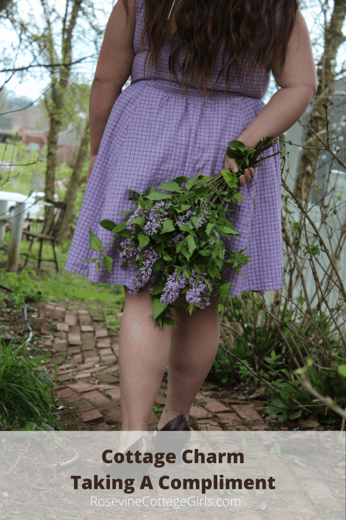 Photo of a woman walking away in a purple dress holding lilacs | Cottage Charm - Taking a Compliment rosevinecottagegirls.com