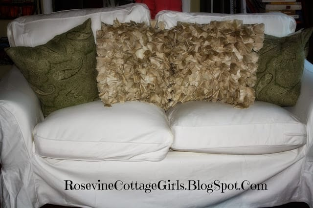 Ikea couch review post | photo of a white slipcovered Ikea Couch with throw pillows | rosevinecottagegirls.com