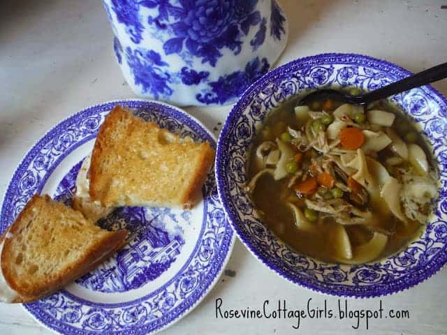 blue and white bowl with chicken noodle soup in it and a plate with a sandwich Chicken noodle soup recipe Rosevine Cottage Girls