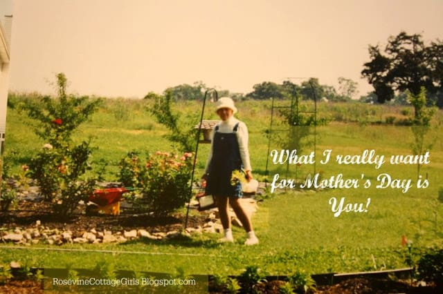 When Mothers Day Hurts | woman in garden in overalls and a garden hat holding plants