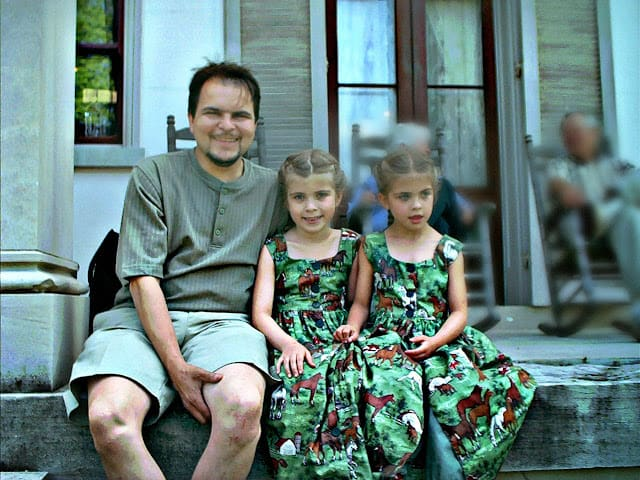 photo of father and daughters on a porch rosevinecottagegirls.com