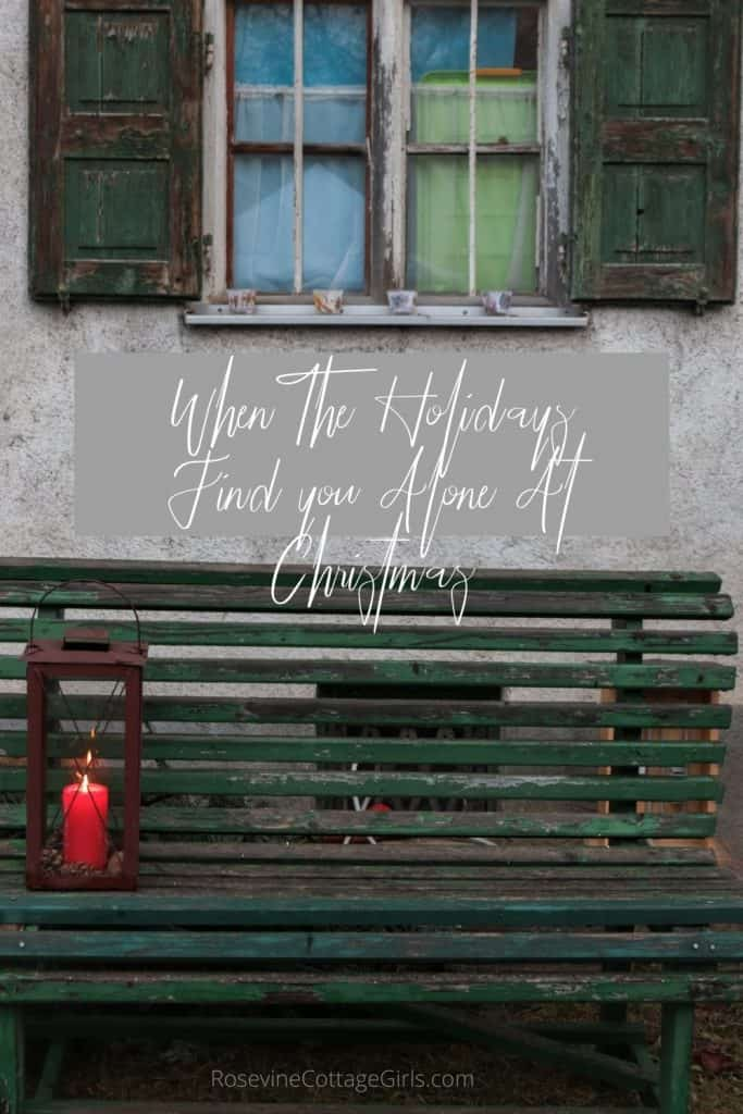 When the holidays find you alone at christmas pinnable 2 | photo of an outdoor bench empty except a red lantern. | rosevinecottagegirls.com