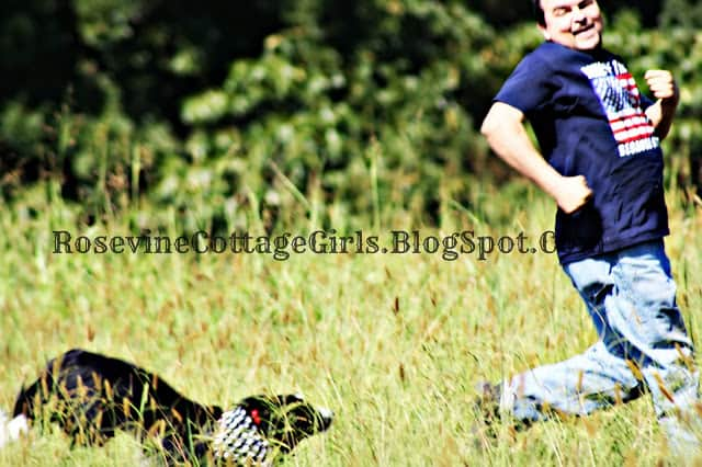 Keep running - photo of man being chased by his dog in a field | rosevinecottagegirls.com