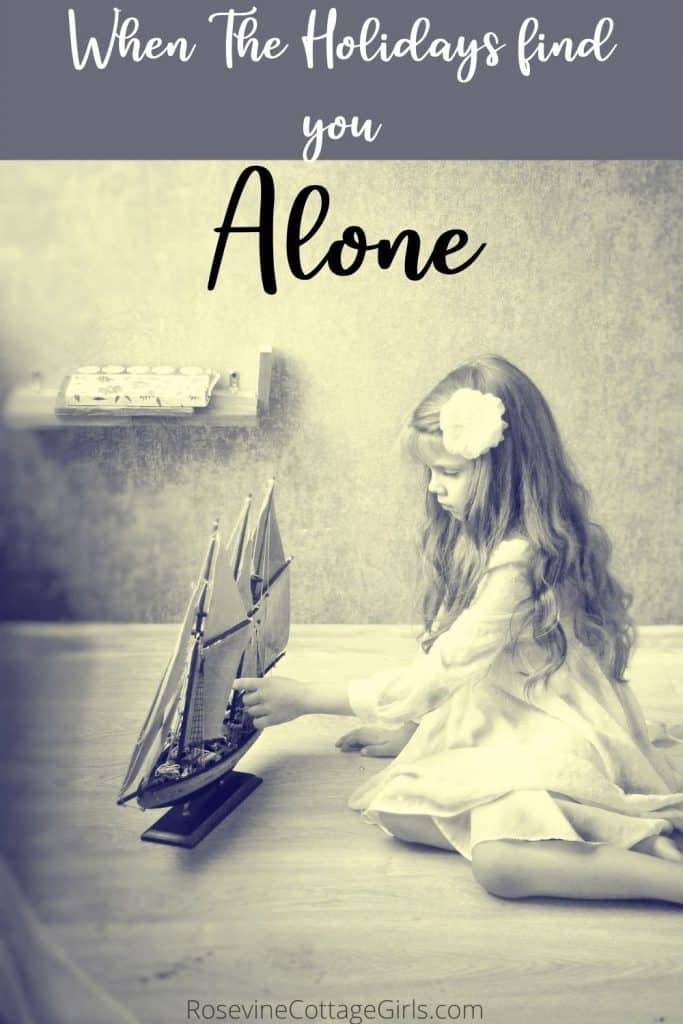 Alone | When the holidays find you alone | photo of a little girl playing with a toy boat on the floor alone | rosevinecottagegirls.com