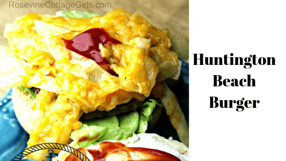 Huntington Beach Burger | A hamburger with strips of fried corn tortillas, melted cheese and spicy taco sauce with lettuce on a homemade bun by RosevineCottageGirls.com