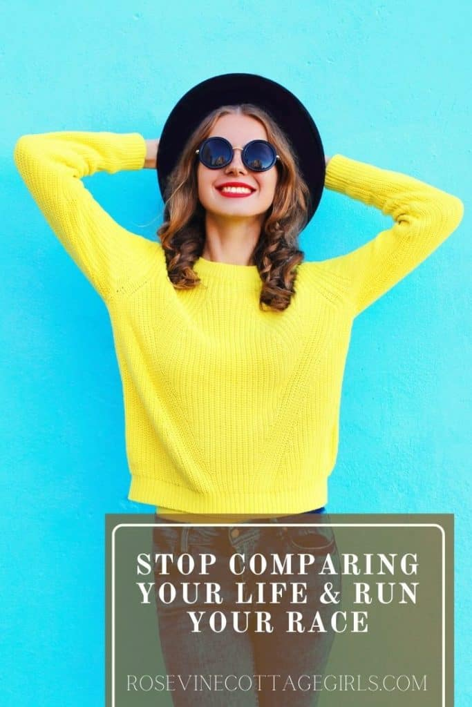 Stop Comparing, run   photo of a lady with a yellow sweater and black hat and sunglasses smiling.   by rosevinecottagegirls.com