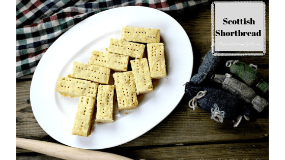 Photo of a plate of scottish shortbread with a tartan and fabric haggis | rosevinecottagegirls.com | Scottish Shortbread, Shortbread, butter shortbread, by Rosevine Cottage Girls