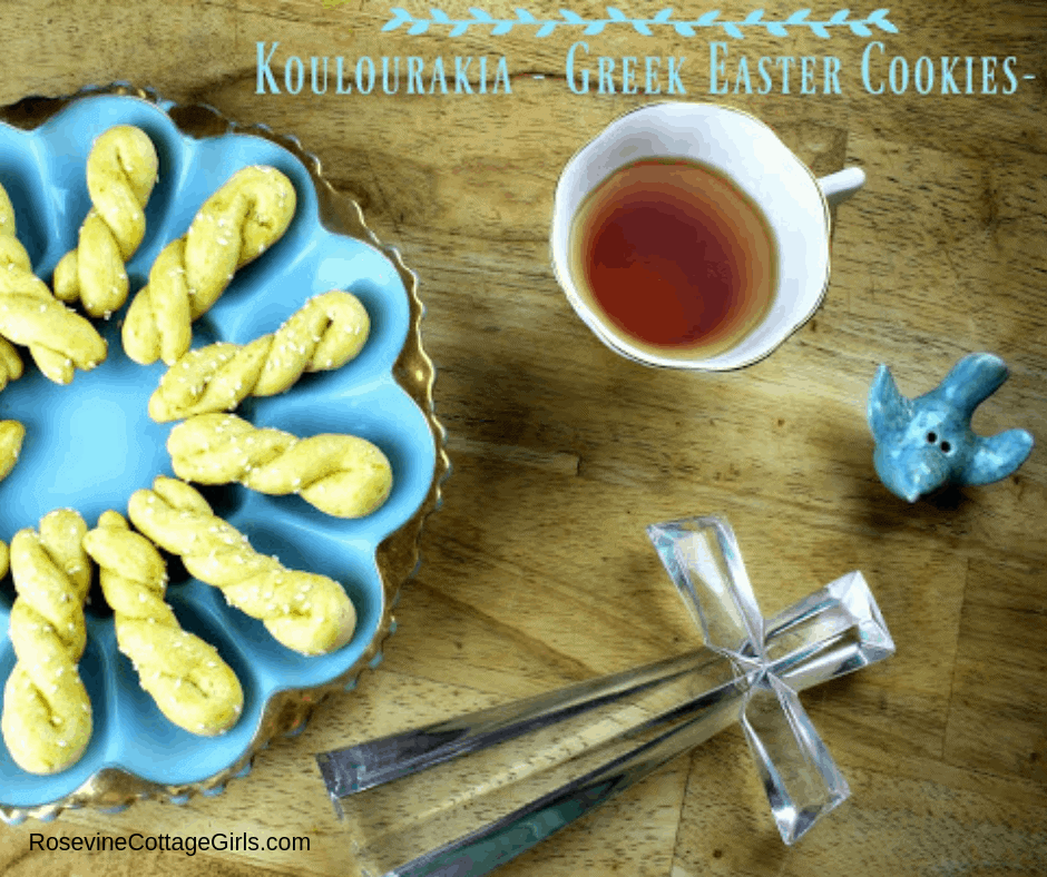 blue plate with greek cookies on it, a cup of tea, a ceramic blue bird and a glass cross | Greek Cookies, Koulourakia, Koulaurakia Cookies, Easter Cookies, Greek Easter Cookies, by Rosevine Cottage Girls