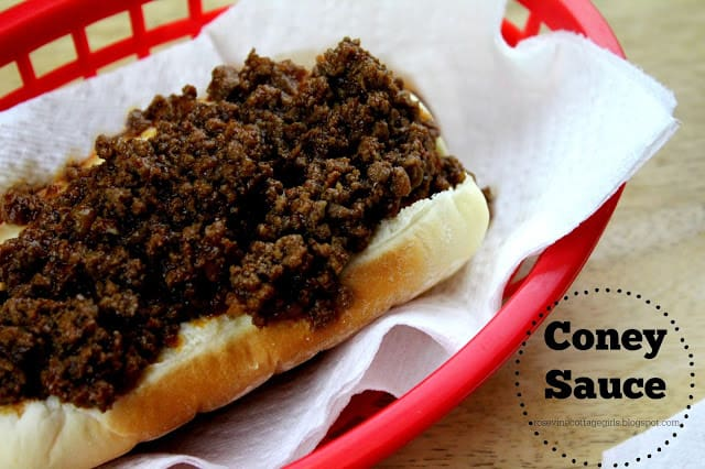 Coney sauce on a hot dog on a red plastic tray with parchment paper | rosevinecottagegirls.com | cony sauce | Cony Island