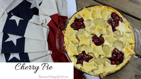 Cherry Pie, photo of a cherry pie on a rustic wooden table with patriotic bunting | rosevinecottagegirls.com