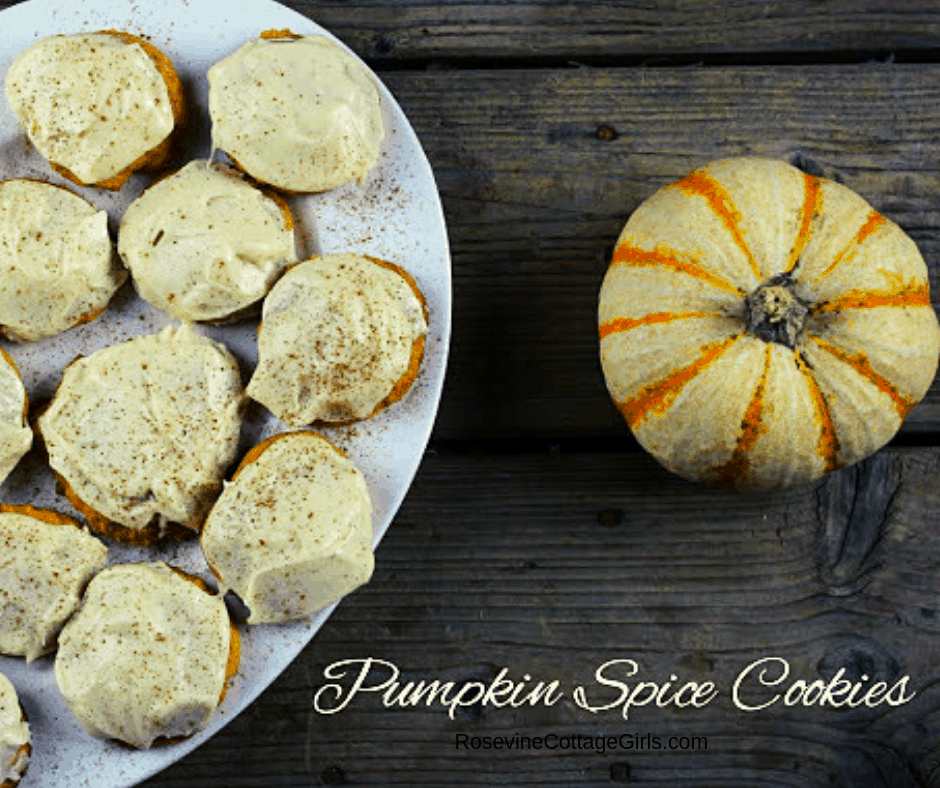 Iced Pumpkin Spice Cookies on a white platter sitting on a wooden background and a small pumpkin sitting near it |Pumpkin Spice Cookies, Pumpkin Cookies, Pumpkin Spice Cookies with Cream Cheese Frosting, By Rosevine Cottage Girls