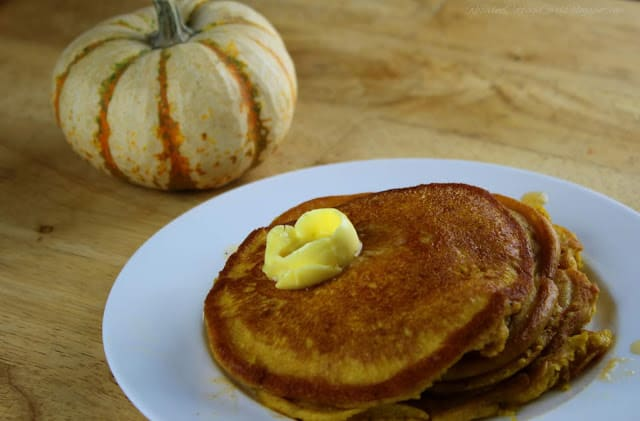 White plate with two pumpkin beside the plate | Pumpkin Pancake Recipe