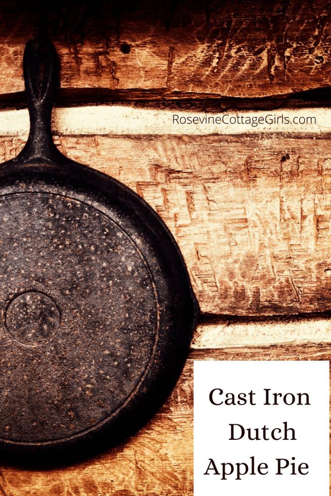 photo of cast iron pan on log wall | Cast Iron Dutch Apple Pie Recipe by rosevinecottagegirls.com