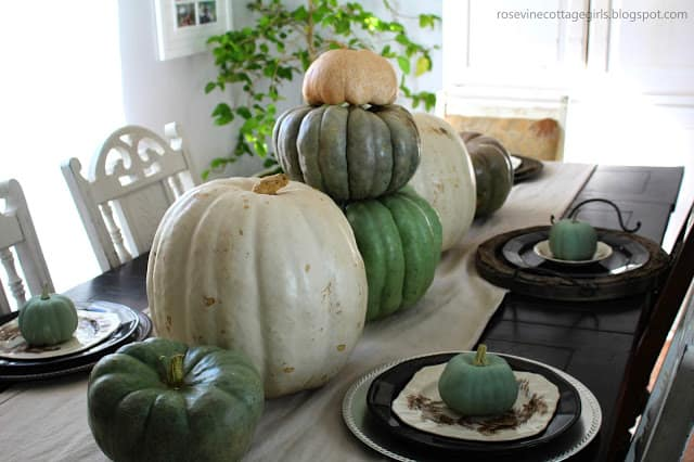 Homey fall dining room | white, blue, green pumpkins with a canvas table runner and black, white and brown plates