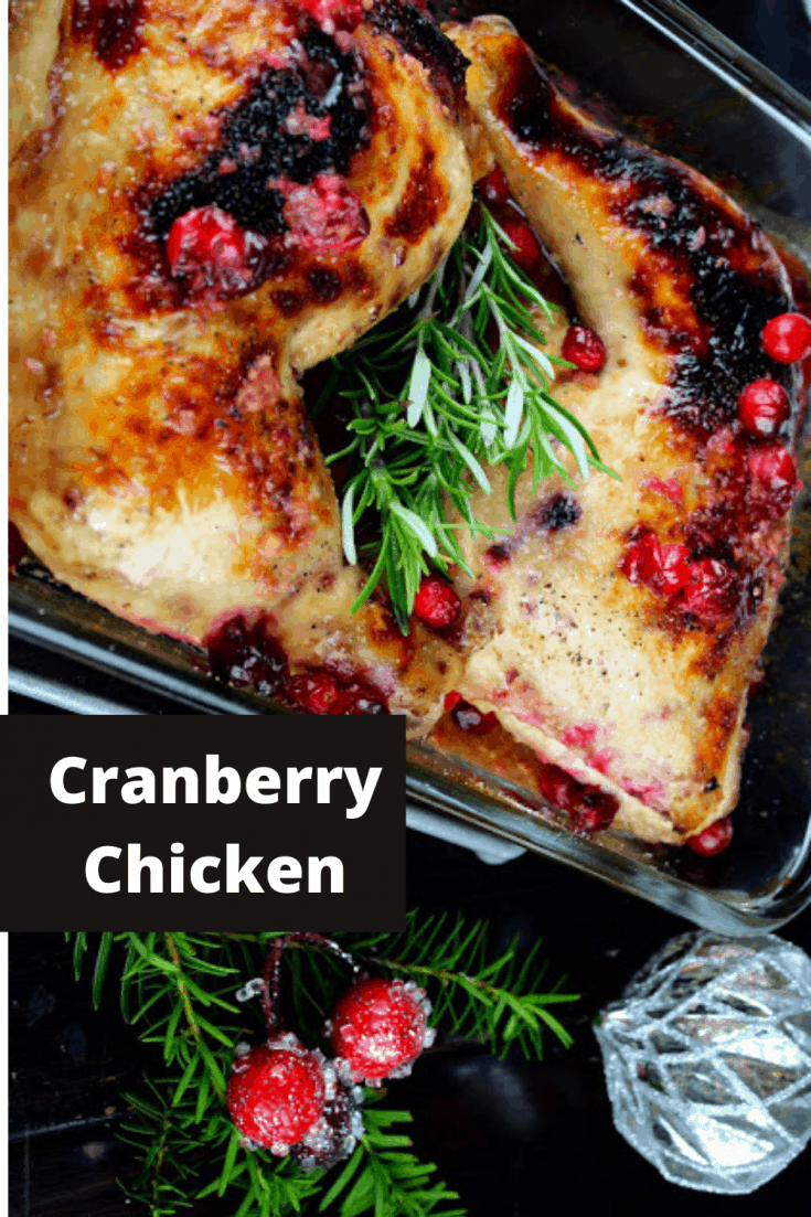 Cranberry Chicken | a pan with cooked chicken and sprigs of rosemary and whole red cranberries | rosevinecottagegirls.com