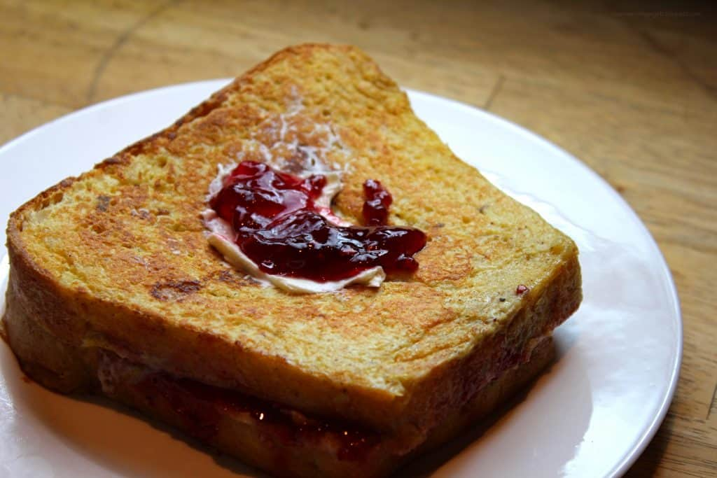 Pain Perdu | White plate with pain perdu and a bit of jam on top. Stuffed French Toast