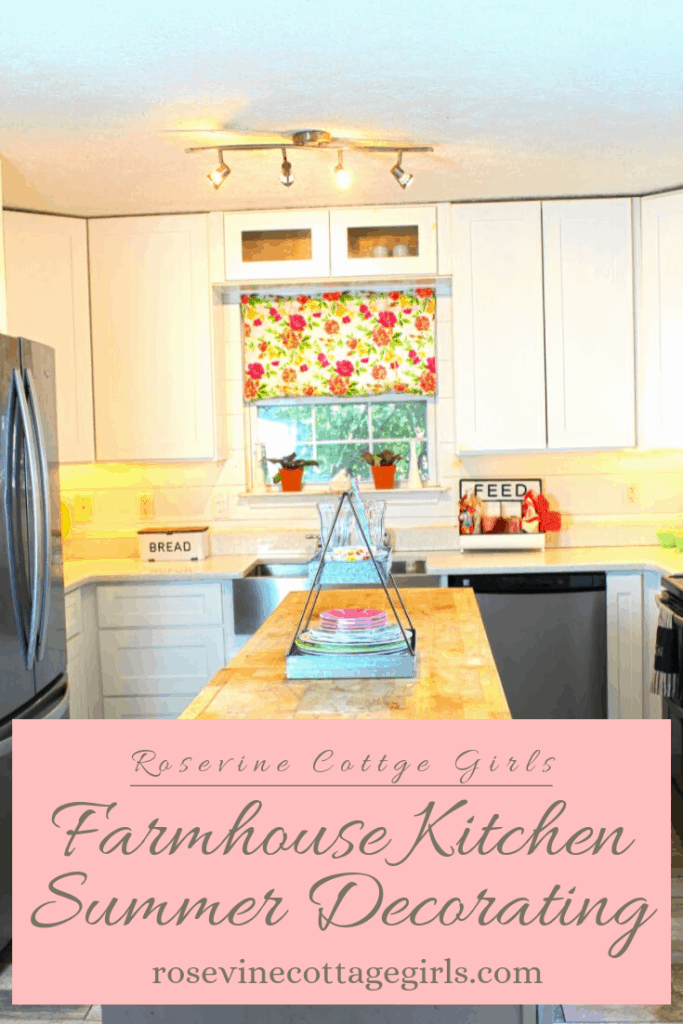 Gorgeous white farmhouse kitchen decorated for summer by the Rosevine Cottage Girls