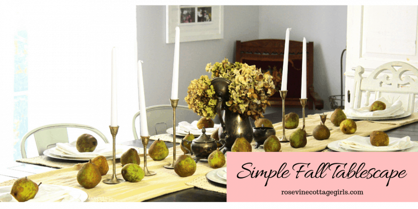 simple fall tablescape a table with table runner, pears, dried hydrangea and candles