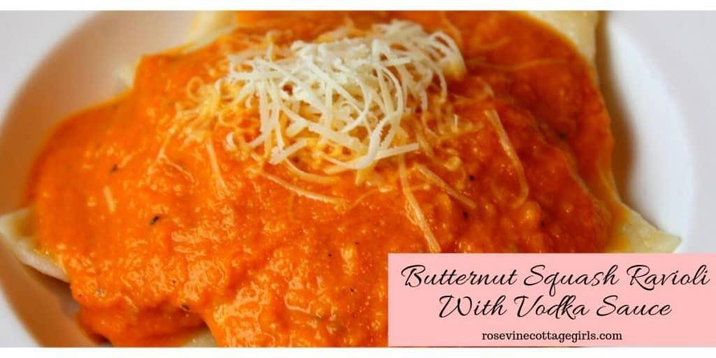 photo of butternut squash ravioli on a white plate with sauce on top and cheese | rosevinecottagegirls.com (c) rosevine cottage girls