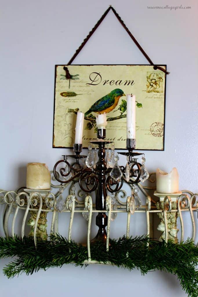 Christmas Decor For The Bathroom, Photo of a metal shelf with a candelabra, candles on candlesticks and beautiful fresh Christmas greenery, rosevinecottagegirls.com
