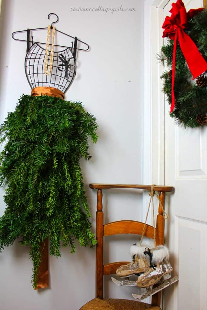 metal dress form for jewelry with christmas greenery and satin ribbon in the bathroom for Christmas. Christmas decor for the bathroom | rosevinecottagegirls.com