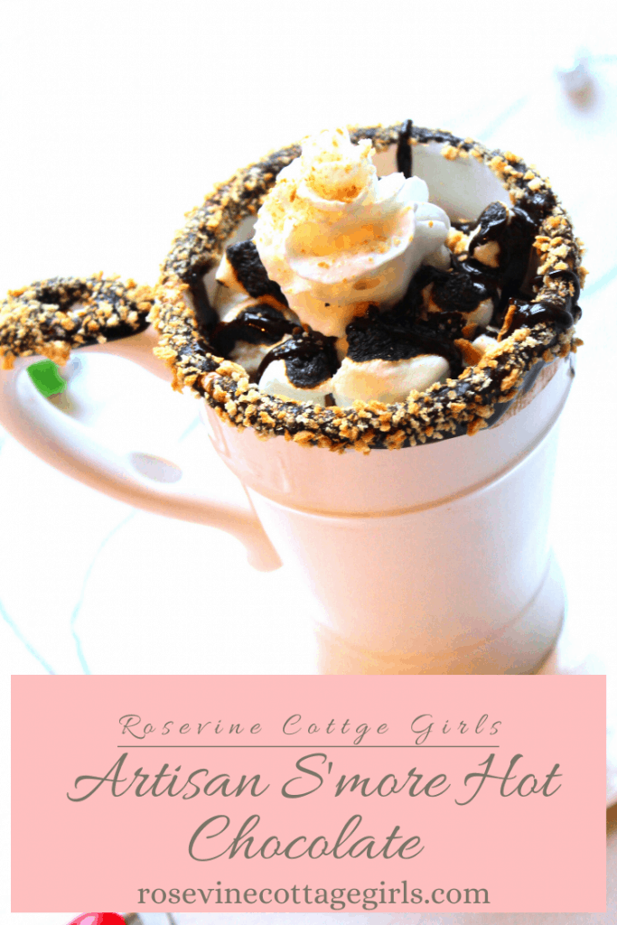 White mug dipped in chocolate and in crushed graham crackers and filled with hot chocolate, whipped cream and chocolate sauce |How to make a delicious homemade artisan s'more hot chocolate recipe #rosevinecottagegirls