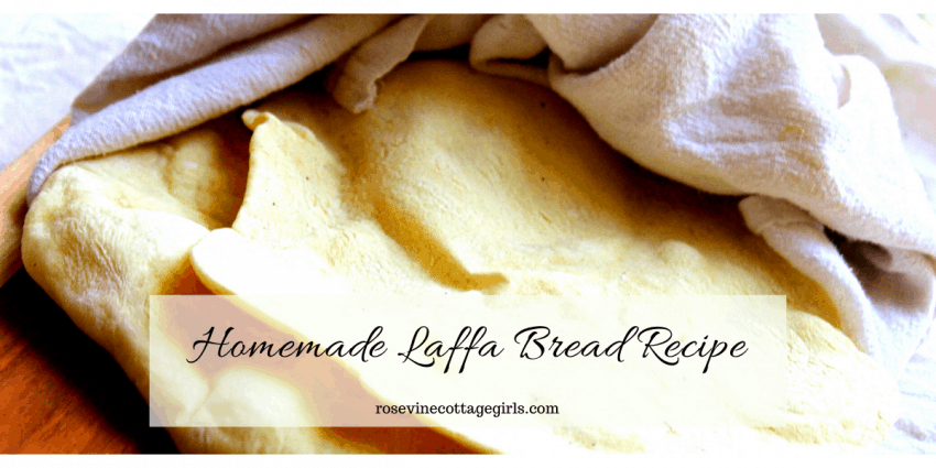 Steaming hot laffa bread under a white cloth | rosevinecottagegirls.comThe best homemade laffa bread recipe! So easy to make and oh so good. #RosevineCottageGirls