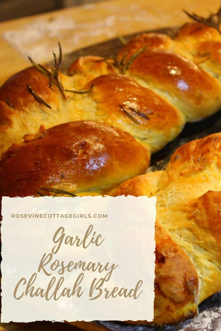 loaf of a braided bread with rosemary sprigs. Text How to make homemade garlic rosemary challah bread #rosevinecottagegirls (c) rosevine cottage Girls | RosevineCottageGirls.com