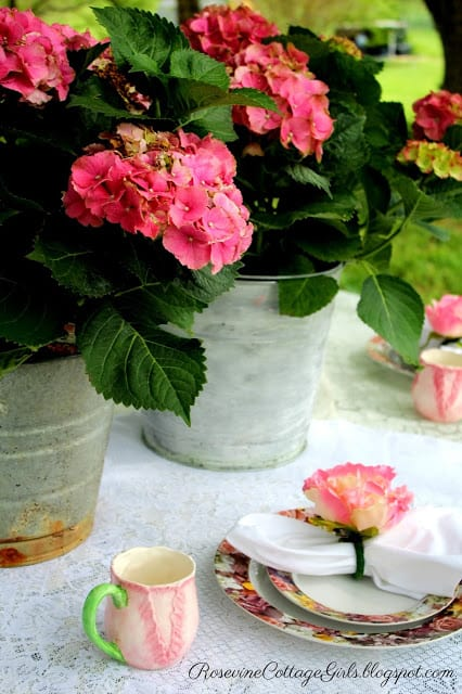Mother's Day Brunch table setting with flowers and beautiful plates by rosevinecottagegirls.com