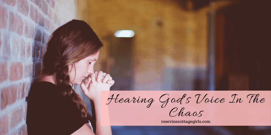 Woman praying in a hallway | Hearing God's Voice In The Chaos