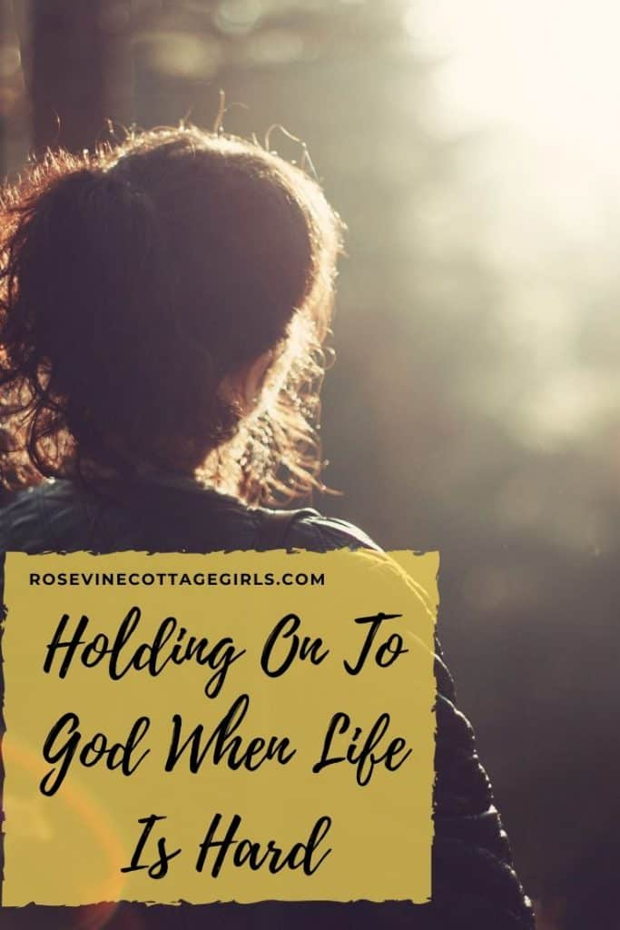 Woman look at a sun set | Holding On To God When Life Brings You To Your Knees