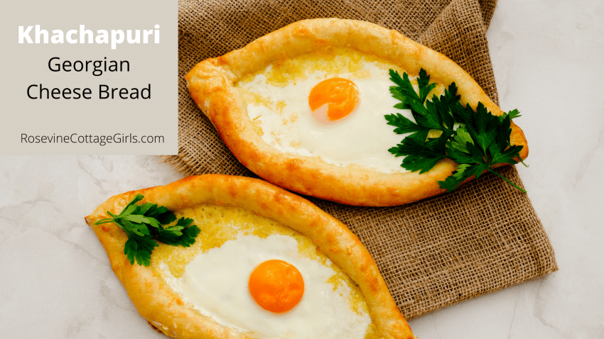 two khachapuri Georgian cheese bread on burlap with sprigs of parsley | khachapuri cGeorgian cheese bread | rosevinecottagegirls.com