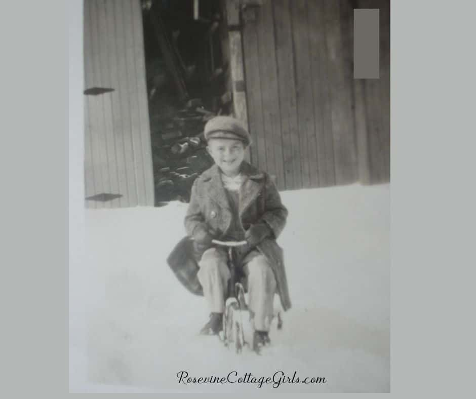 boy riding tricycle in snow | rosevinecottagegirls.com