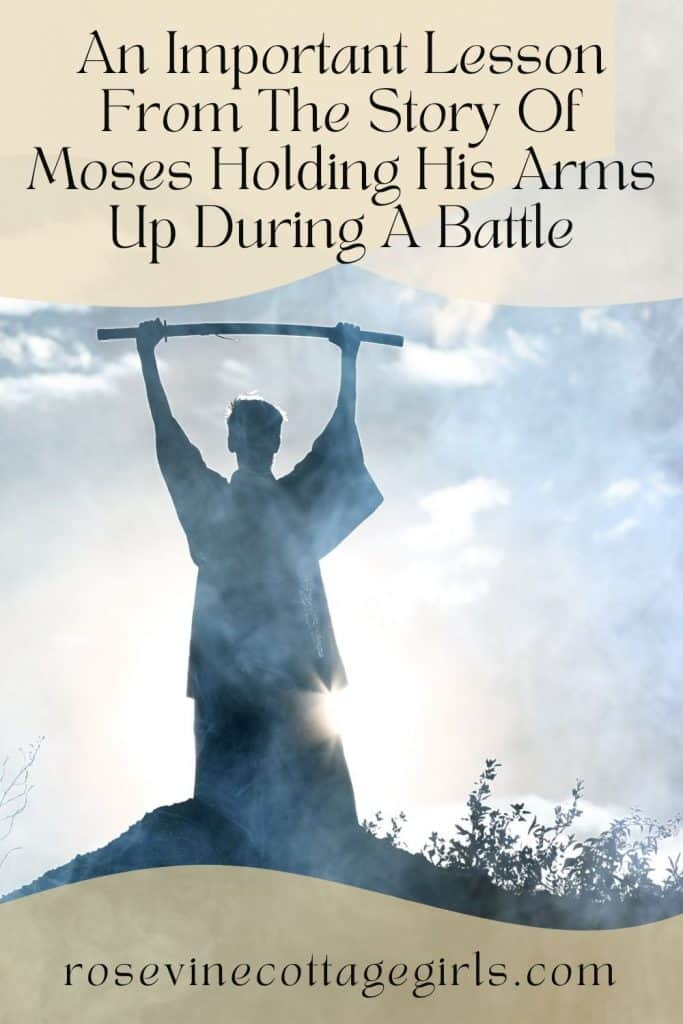 Man holding a staff above his head | Lesson From The Story Of Moses Holding His Arms Up During A Battle