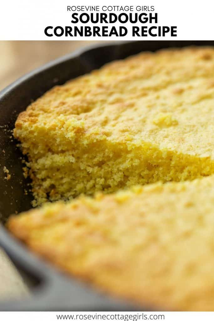 Sourdough Cornbread Pinnable | Close up of a cast iron pan with cornbread and a wedge cut out of it