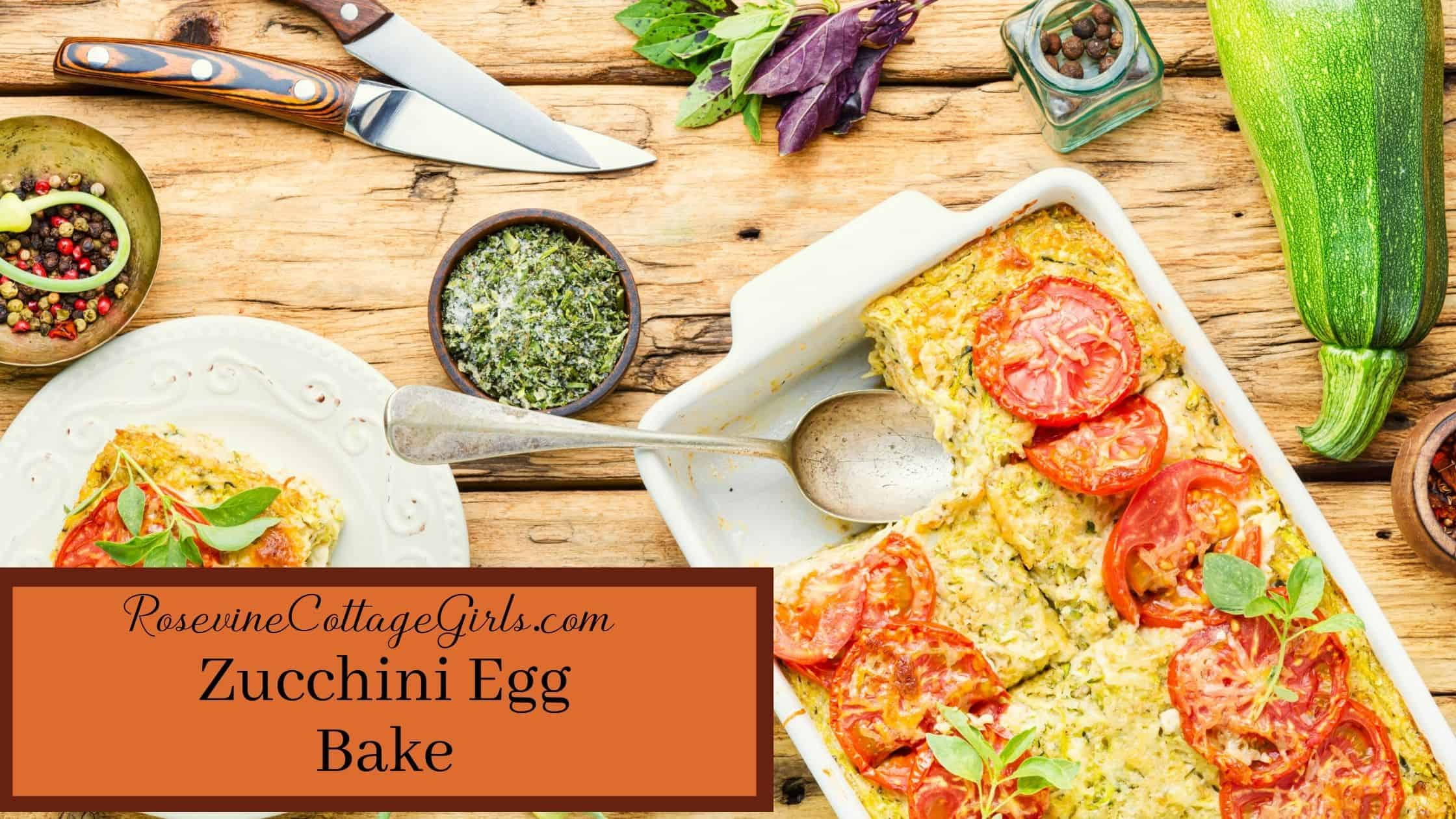 zucchini egg bake main | photo of a zucchini egg bake in a pan with ingredients around it on the table